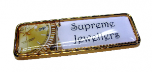 Gold domed name badge